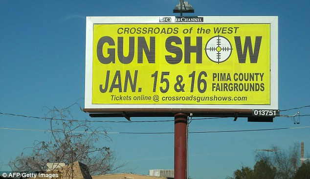 A billboard in Tucson invites residents to a gun show. Arizona has some of the United States' most relaxed rules on gun ownership in the US