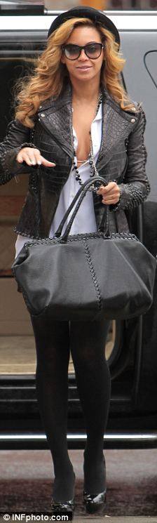 Stylish in the city: Beyonce steps out in a Clockwork Orange-esque bowler hat and sexy leather jacket as she heads to a business meeting in New York