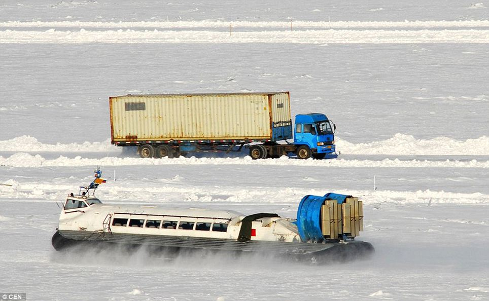 The bitterly cold weather has meant that the Hei Longjiang river in north-east China has frozen so thickly that lorries can cross it from Russia leading to a boom in trade