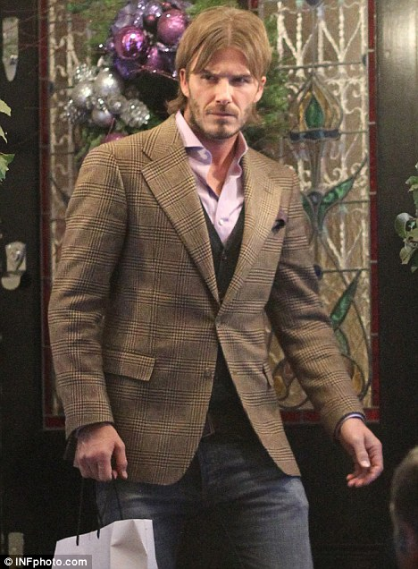 Tweed fan: David teamed a similar jacket with jeans when he attended Gordon Ramsay's Christmas party last year