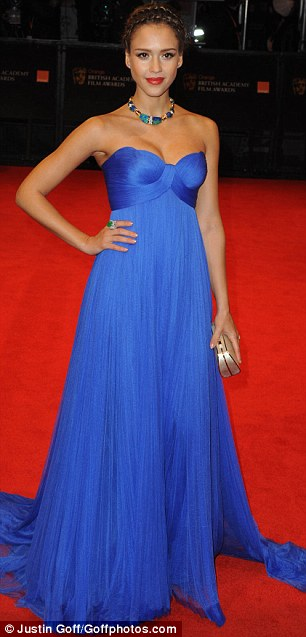 Jessica Alba sported a royal blue strapless gown to add some bright colour to a cold night