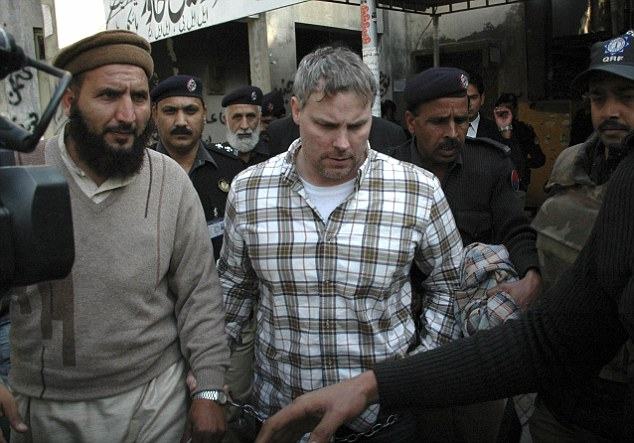 Centre of the storm: Pakistani security officials escort Raymond Allen Davis, centre, to a local court in Lahore on January 28