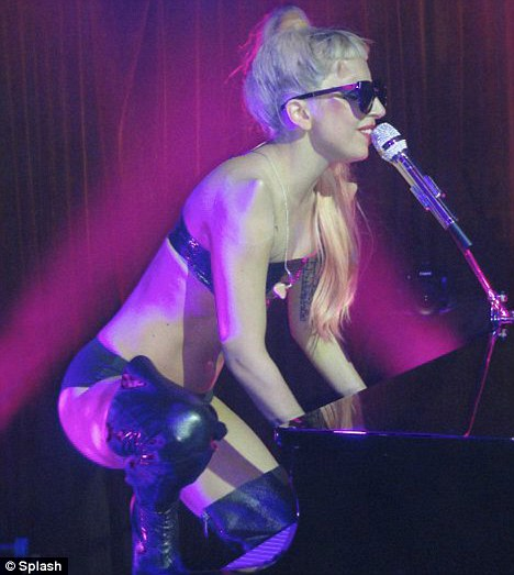 Not shy: The star performed in little more than her underwear at record label Interscope's official Grammy after party in Los Angeles on Sunday night