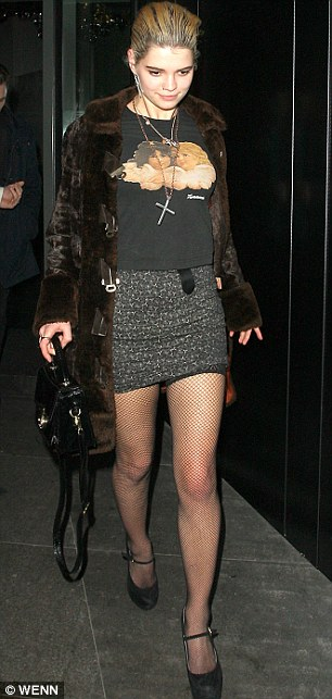 Party goers: Pixie Geldof seemed to be inspired by a 1980s Madonna look as she arrived in fishnet tights, a cherub T-shirt and a cross necklace