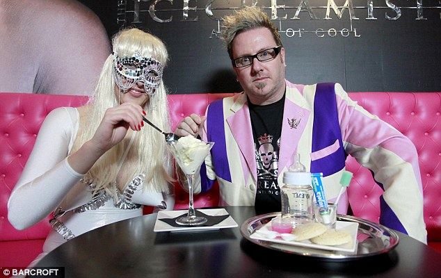 Bizarre: Company founder Matt O'Connor, 44, and the Lady Gaga waitress in the central London store