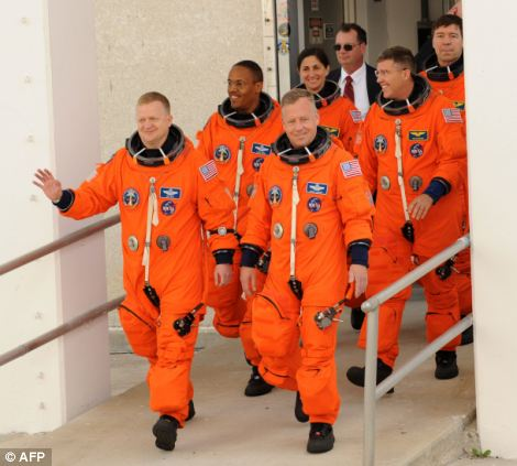 Team effort: Commander Steve Lindsey (front row, right) leads the crew followed by pilot Eric Boe (front, left) and back row, left to right, mission specialists Alvin Drew, Nicole Stott, Steve Bowen and Mike Barratt
