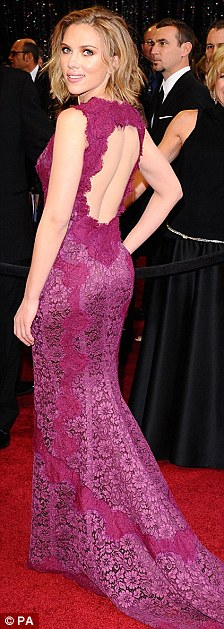 Bringing sexy back: The 26-year-old opted for a raspberry coloured lace Dolce & Gabbana confection
