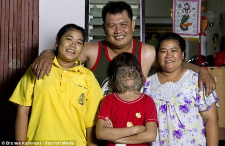 Happily families: Supattra with her sister 15-year-old Sukanya, left, her father Sammrueng and mother Somphon