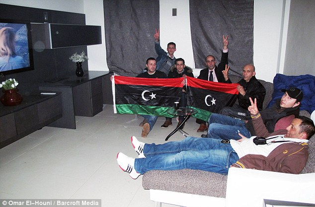 Making themselves at home: The 'Topple the Tyrants' group enjoy the luxury of Saif Gaddafi's £11m home in Hampsted