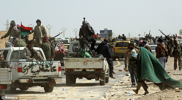 Chaotic: The fighters could not resist the full onslaught of Gaddafi's troops who have fought back after initial defeat