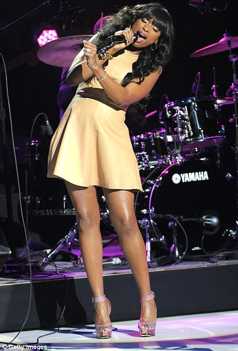 She's got legs: Jennifer Hudson belts out her new single Where You At in New York while revealing her shapely legs in a leather mini-dress