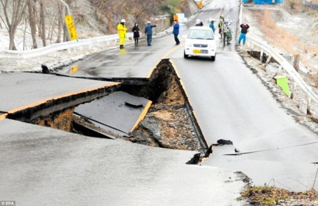 Shock: The full destructive power of the earthquake is evident in this concrete road in Fukushima prefecture that was snapped in half by the disaster