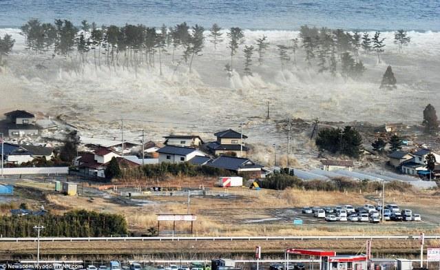 Doomed: A massive tsunami engulfs stranded homes aon the coast of Natori, Miyagi Prefecture, after the earthquake struck