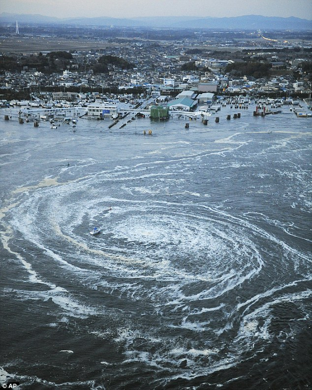 A whirlpool caused by currents from a tsunami near the port of Oarai after Japan was struck by a strong earthquake off its north-eastern coast today