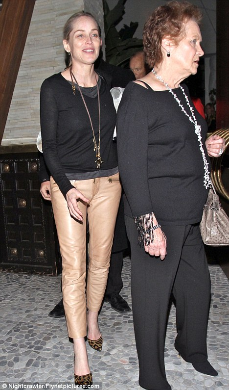 Hell for leather: Sharon Stone stepped out in a stylish combination of beige leather pants and animal print stilettos for a quiet dinner with her mother Dorothy Stone at Red O restaurant in West Hollywood, last night