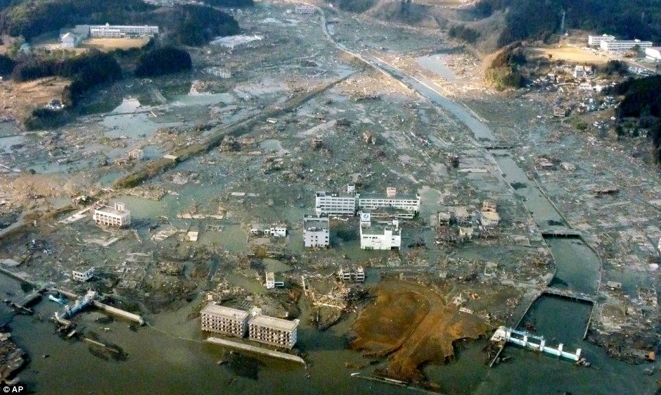 Catastrophe: The true scale of the devastion that the tsunami unleashed is clear in this picture of the port city of Minamisanriku town where 10,000 people are unaccounted for