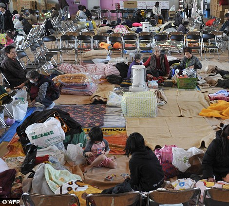 Residents shelter in an evacuation center at Sendai city in Miyagi prefecture on March 14, 2011