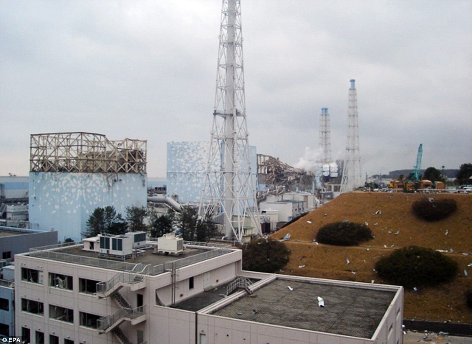 the destruction and white smoke from reactor block 3 (3-L) and remains of reactor block number 4 (R), after both blocks suffered heavy damage following explosions.