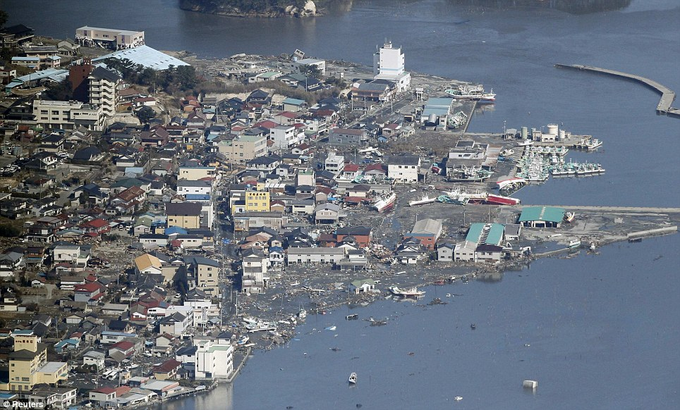 Desperate plight: Although many buildings were left standing, the town has still been devastated by last Friday's tsunami