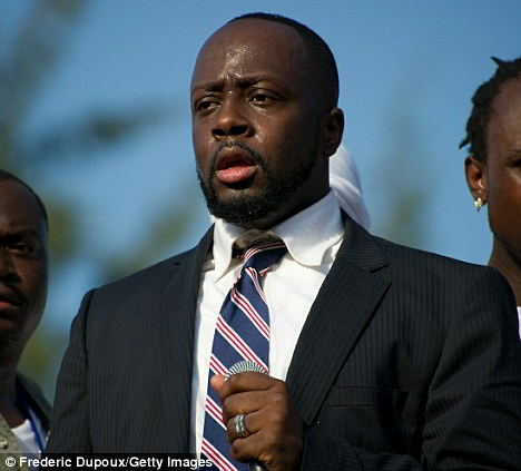 Shot: Rapper Wyclef Jean canvassing for support in August last year in Port-au-Prince, Haiti. The singer was disqualified for running for president but is supporting fellow musician Michel Martelly