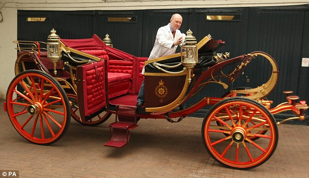 Royal wedding: The 1902 State Landau, built by Hoopers for Edward VII's coronation, gets a polish up in the Royal Mews