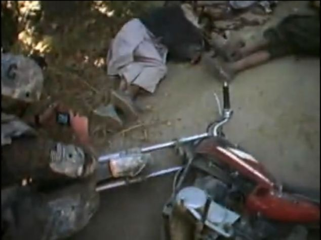 Horror: A released video shows an incident in which two Afghans on a motorcycle are gunned down
