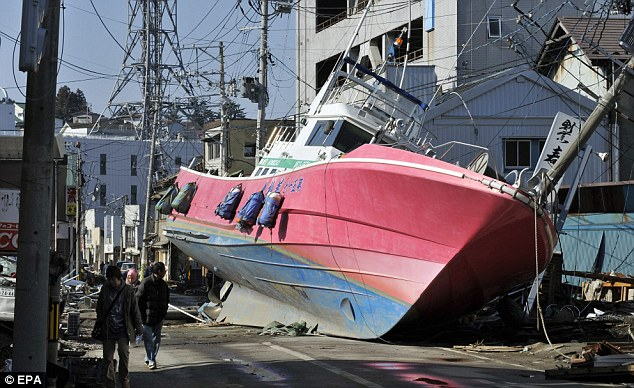 Out of place: A fishing boat sits in the middle of a road road, washed ashore by the tsunami in Ishinomaki
