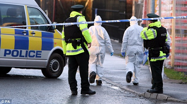 Search: Forensic officers examine the area around the bomb blast. Mr Kerr's murder has been condemned by political figures in Northern Ireland