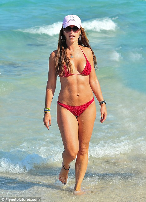 Look at me: Real Housewives of Miami star Cristy Rice showed off her toned physique during an afternoon on the beach yesterday