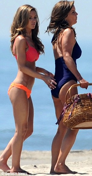 Like mother like daughter: The similar-looking pair brought a picnic basket down to the beach for lunch while they were filming the reality TV show