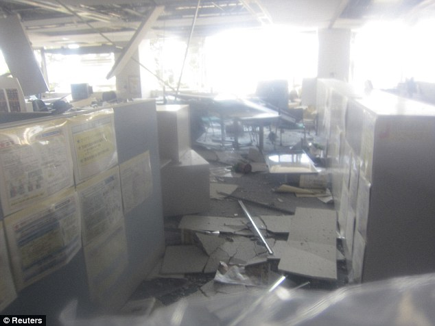 Damage: Girders hanging down and rubbish everywhere, this is the second floor of the main building at Fukushima