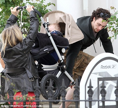 Sam Taylor Wood and fiancé Aaron Johnson carry daughter ...