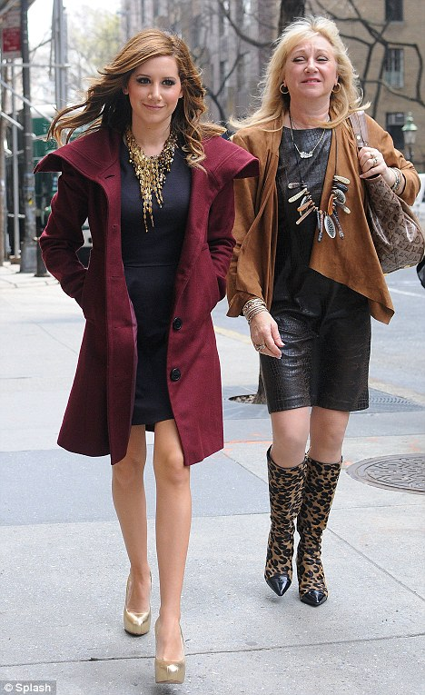 Like mother, like daughter: Ashley Tisdale makes the promotional rounds in New York with her mother Lisa today