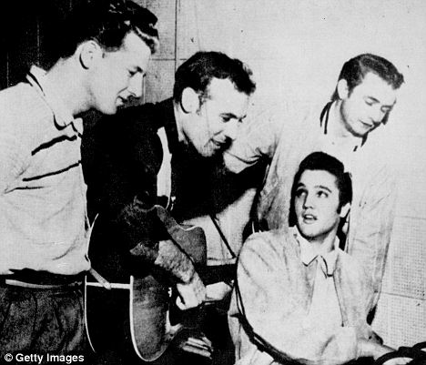 Back in the day: This picture, taken in 1956, shows Jerry Lee, Johnny Cash, Carl Perkins and Elvis at a jamming session in Memphis