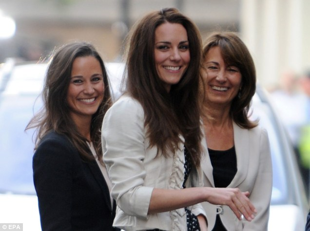 Here come the Middletons: Pippa, Kate and mother Carole smile to the crowds as they arrive at the Goring Hotel ahead of Kate's marriage to Prince William tomorrow