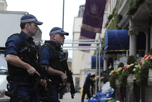 Ring of steel: Armed police are on guard outside the Goring Hotel in central London where Kate Middleton and her family are staying tonight