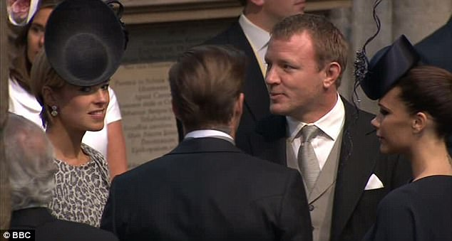David and Victoria Beckham talk to Guy Ritchie inside Westminster Abbey as they wait for William and Kate to arrive