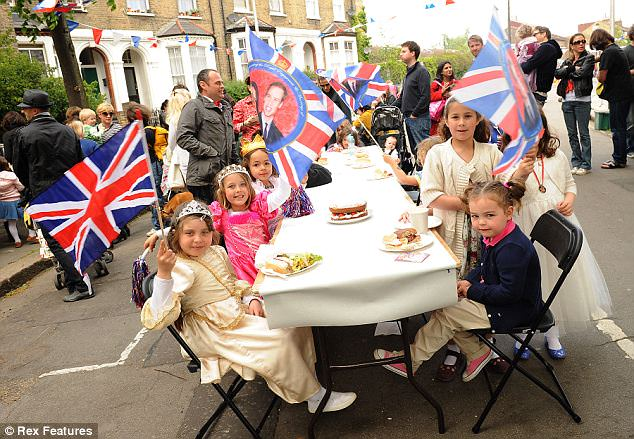Capital fun: Children in fancy dress wave flags at a Street Party in Lupton Street, Kentish Town, London