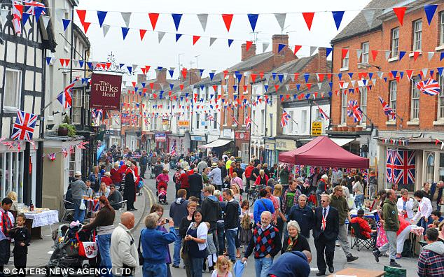 Jerusalem: The high street in Alcester, Warwickshire, where one of the largest street parties in the UK is taking place, has been decked with bunting and blocked off to traffic as loyal Brits celebrate