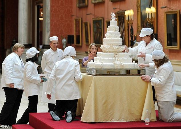 Team work: Fiona Cairns (back) instructs her Royal Wedding cake team during the finishing touches at Buckingham Palace