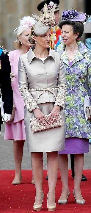 Lady Sophie Windsor was the most beautiful wedding guest in a cocktail dress and coat by Giorgio Armani Prive, with exaggerated shoulders and graphic hat