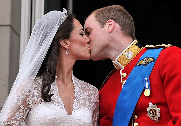 Seize the moment: And Kate duly obliged as she entered into a passionate embrace with her new husband