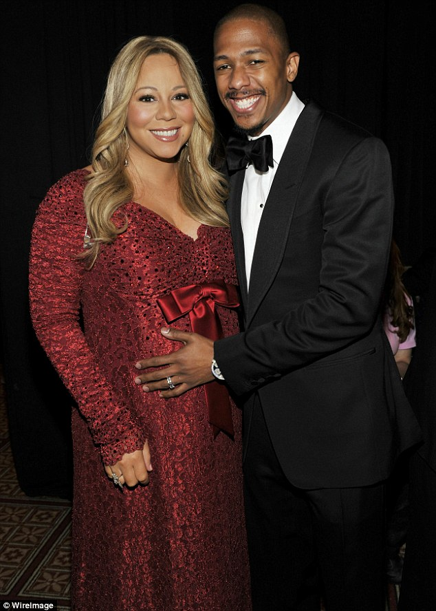 Happy news: Mariah Caery, pictured with husband Nick Cannon in December, has given birth to twins today in Los Angeles on her wedding anniversary