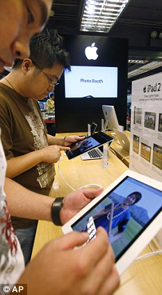 Must have: High demand for iPods and iPads in the west has fuelled the tough working conditions for part suppliers in China