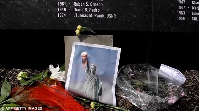 At the Pentagon Memorial in Washington, tributes include an image of the statue of Liberty holding the severed head Bin Laden