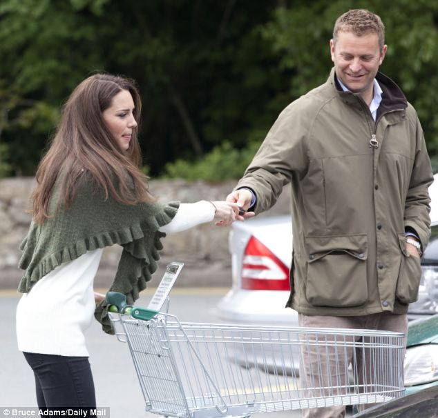 Happy shopper: The new Duchess of Cambridge looks relaxed at the supermarket with her protection officer