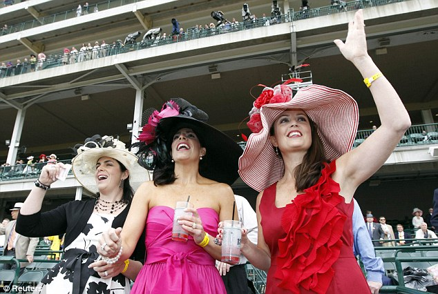 Going for the win: A group of ladies cheered on their horse while wearing bright attire and the requisite large hats
