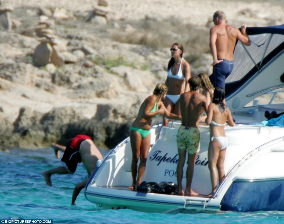 ... but the young royal finishes with an ungainly belly-flop into the water