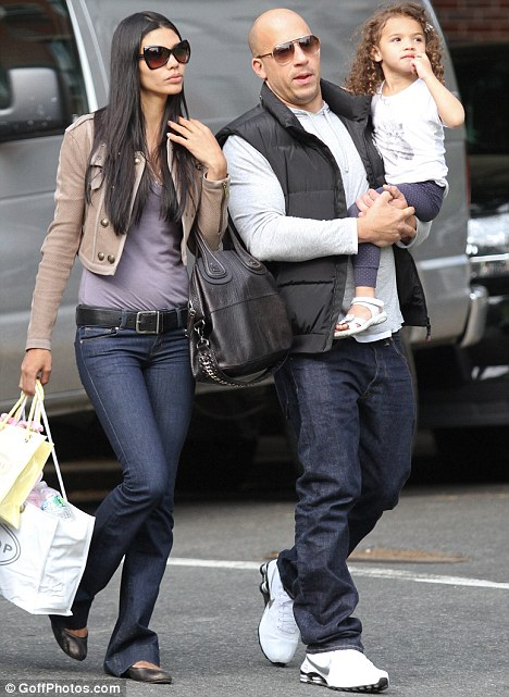 Family day out: Vin Diesel with his girlfriend Paloma Jimenez and their daughter Hania Riley in New York yesterday