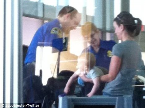 Disturbing: A photograph, showing a baby being subjected to a full-body search by airport security caused outrage when it was posted online